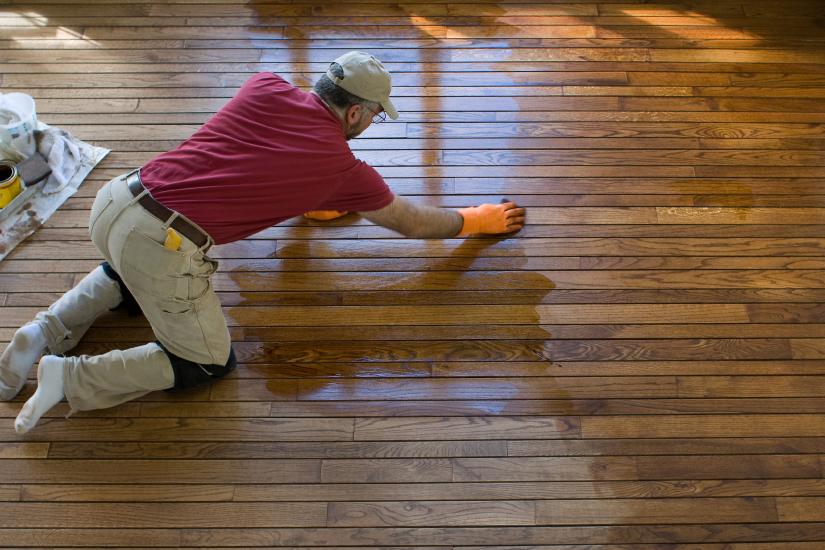 a hardwood floor refinisher in Trenton, NJ working on a floor