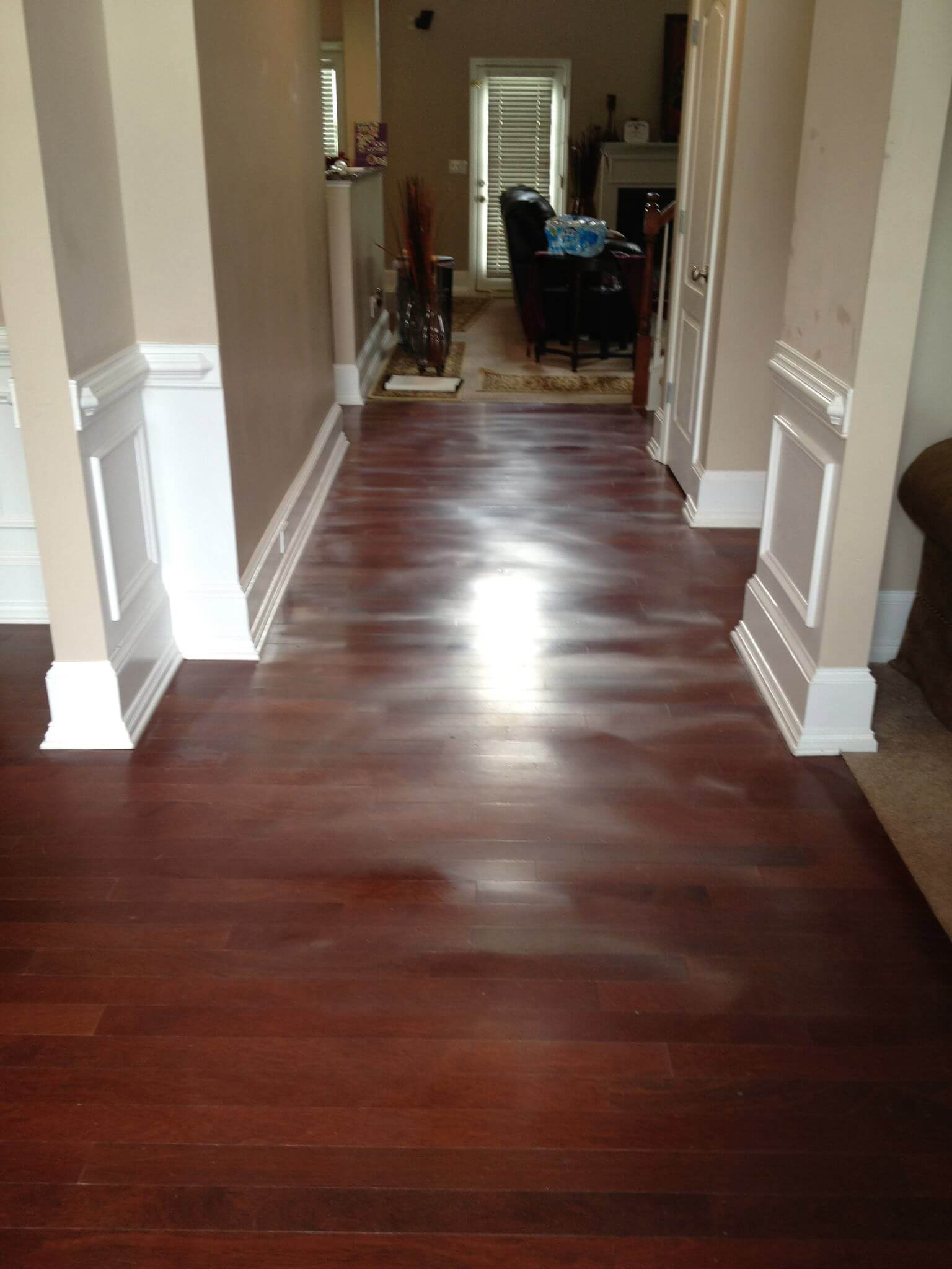 warped and scratched hardwood flooring
